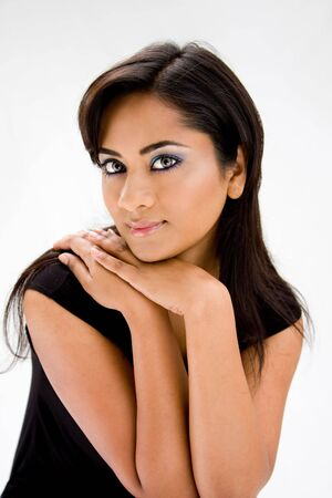 beautiful indian girl face: Face of a beautiful Hindi woman with subtle blue eye makeup and strong eyes, isolated