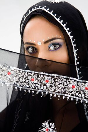 pakistani females: Beautiful woman with black head scarf, isolated