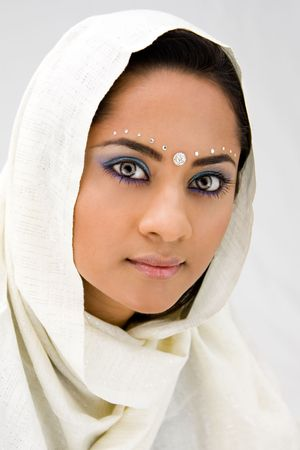 Beautiful woman with white head scarf, isolated photo