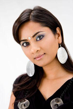Beautiful woman with rhinestones and bindi, isolated photo