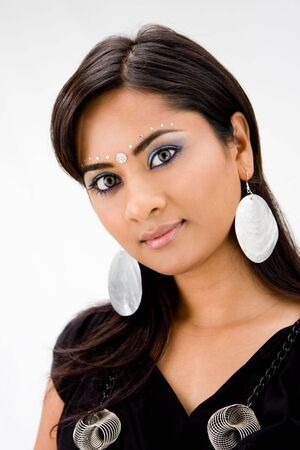 beautiful indian girl face: Beautiful woman with rhinestones and bindi, isolated Stock Photo