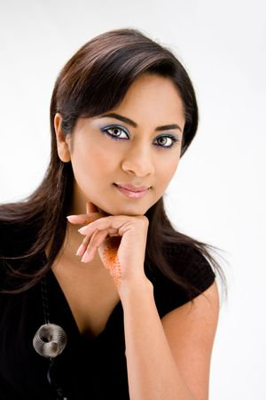 sincere girl: Face of a beautiful Hindi woman with subtle blue eye makeup and strong eyes, isolated