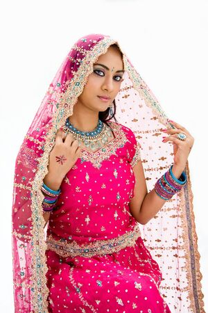 pakistani females: Beautiful Bangali bride in colorful dress and veil, isolated