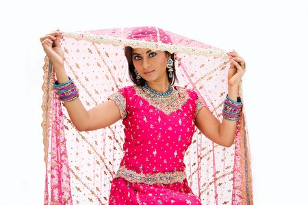 Beautiful Bangali bride in colorful dress and lifting her veil, isolated photo