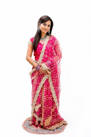 Beautiful Bangali bride in colorful dress standing, isolated Stock Photo