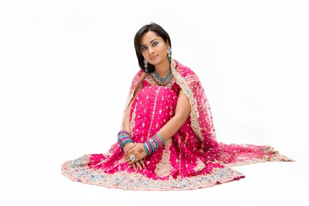 pakistani females: Beautiful Bangali bride in colorful dress sitting, isolated