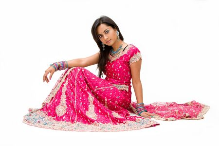 Beautiful Bangali bride in colorful dress sitting, isolated Stock Photo - 3746861