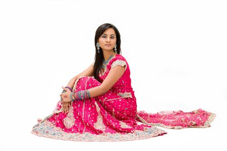 sari: Beautiful Bangali bride in colorful dress sitting, isolated