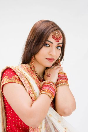 pakistani females: Beautiful Bangali bride in colorful dress, isolated