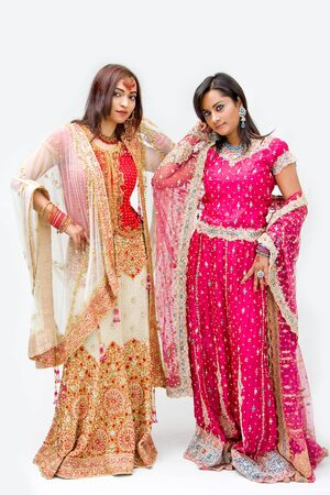 Two beautiful Bangali brides in colorful dresses, isolated photo