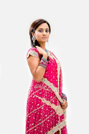 Beautiful Bengali bride in colorful dress, isolated photo