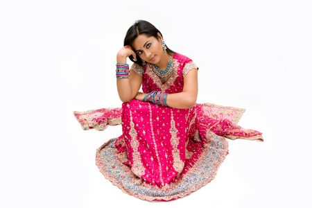 Beautiful Bengali bride in colorful dress day dreaming, isolated photo
