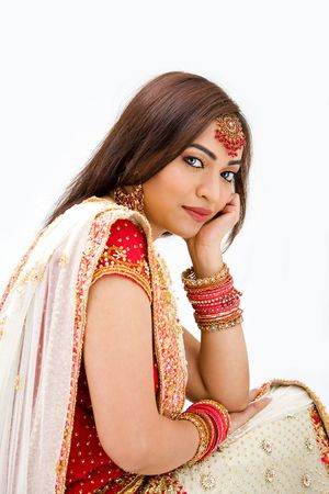 pakistani: Beautiful Bengali bride in colorful dress day dreaming, isolated Stock Photo