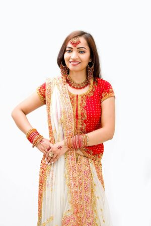 bengali: Beautiful Bengali bride in colorful dress, isolated