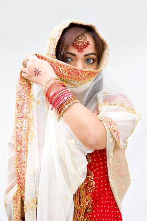 bengali: Elegant Bengali bride with veil in front of mouth, isolated