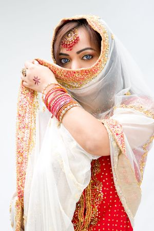 pakistani females: Elegant Bengali bride with veil in front of mouth, isolated
