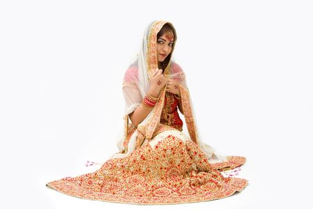 pakistani females: beautiful harem girl or belly dancer or Hindu bride sitting, isolated Stock Photo