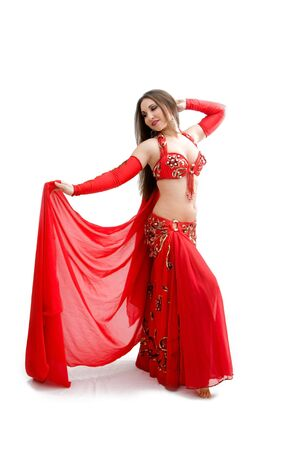 harem: Beautiful belly dancer in red outfit holding veil, isolated