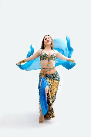 egyptian woman: Beautiful belly dancer in blue outfit holding veil, isolated