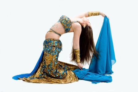 kneeling woman: Beautiful belly dancer in blue outfit holding veil bending backward, isolated Stock Photo