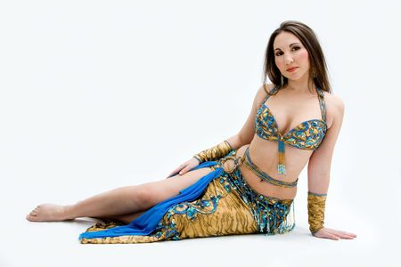 turkish woman: Beautiful belly dancer in blue outfit laying on floor, isolated