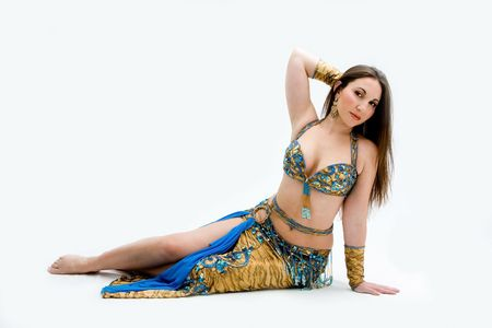 harem: Beautiful belly dancer in blue outfit laying on floor, isolated