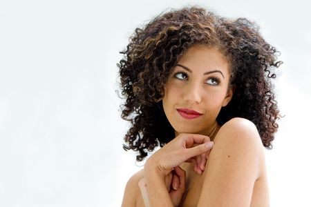 sincere: Sincere beautiful young woman with brown curly wild hair and bare shoulders, isolated Stock Photo