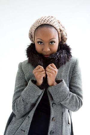 Beautiful African woman wearing gray winter wear, isolated