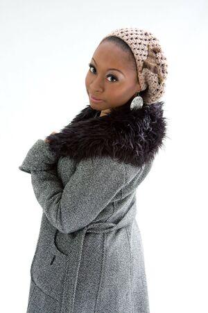 winter fashion: Beautiful African woman wearing gray winter wear, isolated