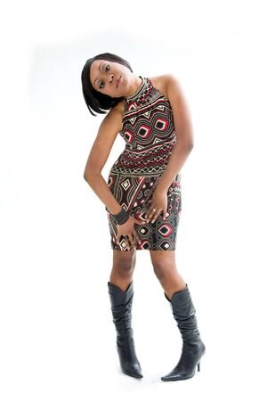 awkward: Beautiful African woman in the seventies style standing awkward, isolated Stock Photo