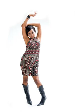 curved leg: Beautiful African woman in the seventies style standing and dancing with arm up above her head, isolated