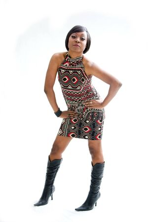 Beautiful African woman in the seventies style standing with hands on hips, isolated