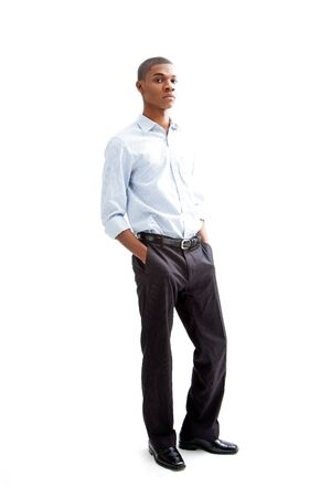 Young African business man standing relaxed and secure with hands in pocket, isolated Stock Photo - 4054098