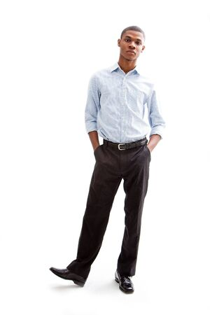 Young African business man standing relaxed and secure with hands in pocketand foot up, isolated Stock Photo - 4054101