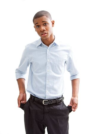 broke: Broke young African business man standing pulling out his pocket, isolated Stock Photo