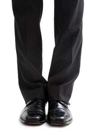 Hose: Beine und F��e ein Gesch�ftsmann in Hosen und schwarze Schuhe anziehen, isoliert Lizenzfreie Bilder