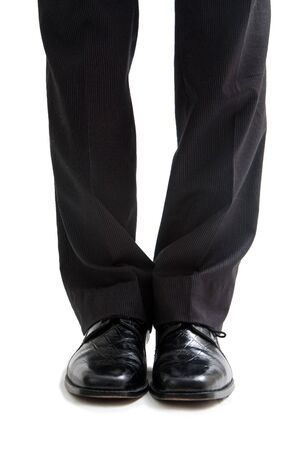 Legs and feet of a business man in black pants and dress shoes, isolated