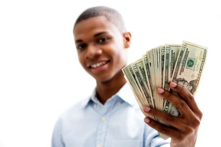 African man smiling and holding money, isolated
