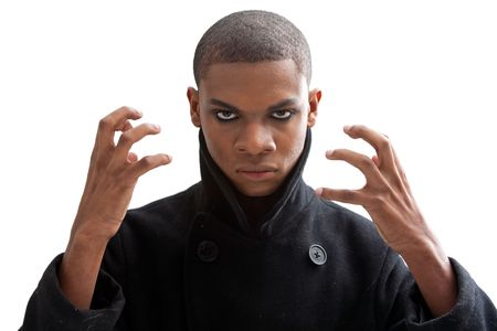 African man with smokey eyes, strong expression and black coat, isolated photo