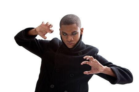 African man with smokey white eyes, strong expression and black coat, isolated photo