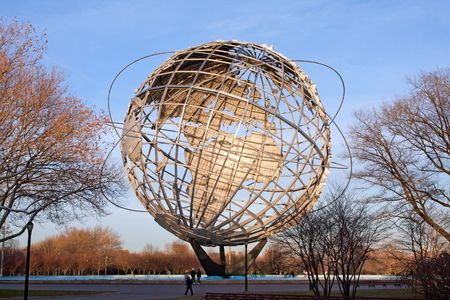 flushing: Unisphere globe in Flushing Meadows Corona Park in Queens New York at sunset