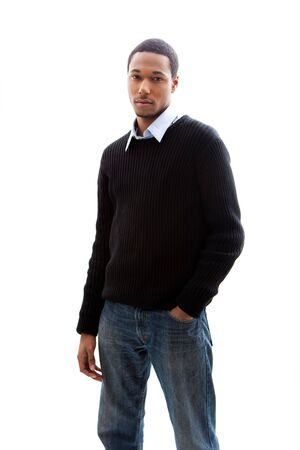 black sweater: Handsome African American male in blue shirt black sweater and jeans standing, isolated
