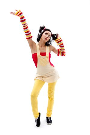 ponytails: Beautiful fun latina girl with bright colored arm warmers and ponytails with red ribbons in her hair standing with hand in air, isolated Stock Photo