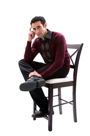 Handsome guy wearing business casual clothes sitting on a high chair and thinking, isolated Stock Photo - 4278035