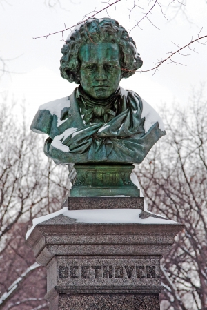 Snow covered green copper statue of Ludwig van Beethoven in the mall in Central Park, New York City photo