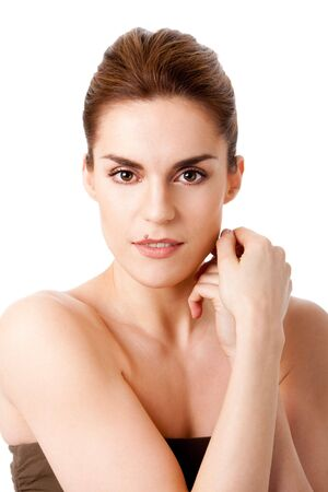 sincere: Beautiful brunette face with mole on lip and hands next to head, natural and pure, isolated Stock Photo