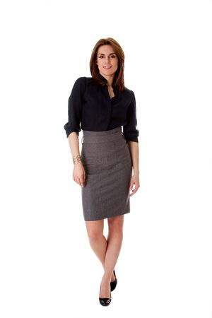 Beautiful brunette business woman in walking pose wearing gray skirt and blue blouse, isolated