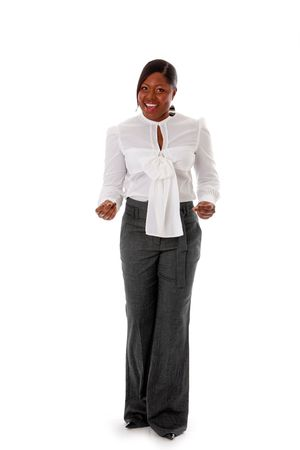 Beautiful African American business woman dressed in a white shirt and gray pants standing, snapping fingers, isolated photo