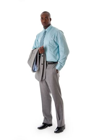 Handsome African American man in gray suit standing with hand in pocket and blazer over arm, isolated Stock Photo - 4828845
