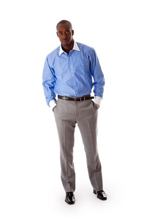 Handsome African American business man standing tilted with hands in pocket, wearing blue pinstripe shirt and gray pants, isolated